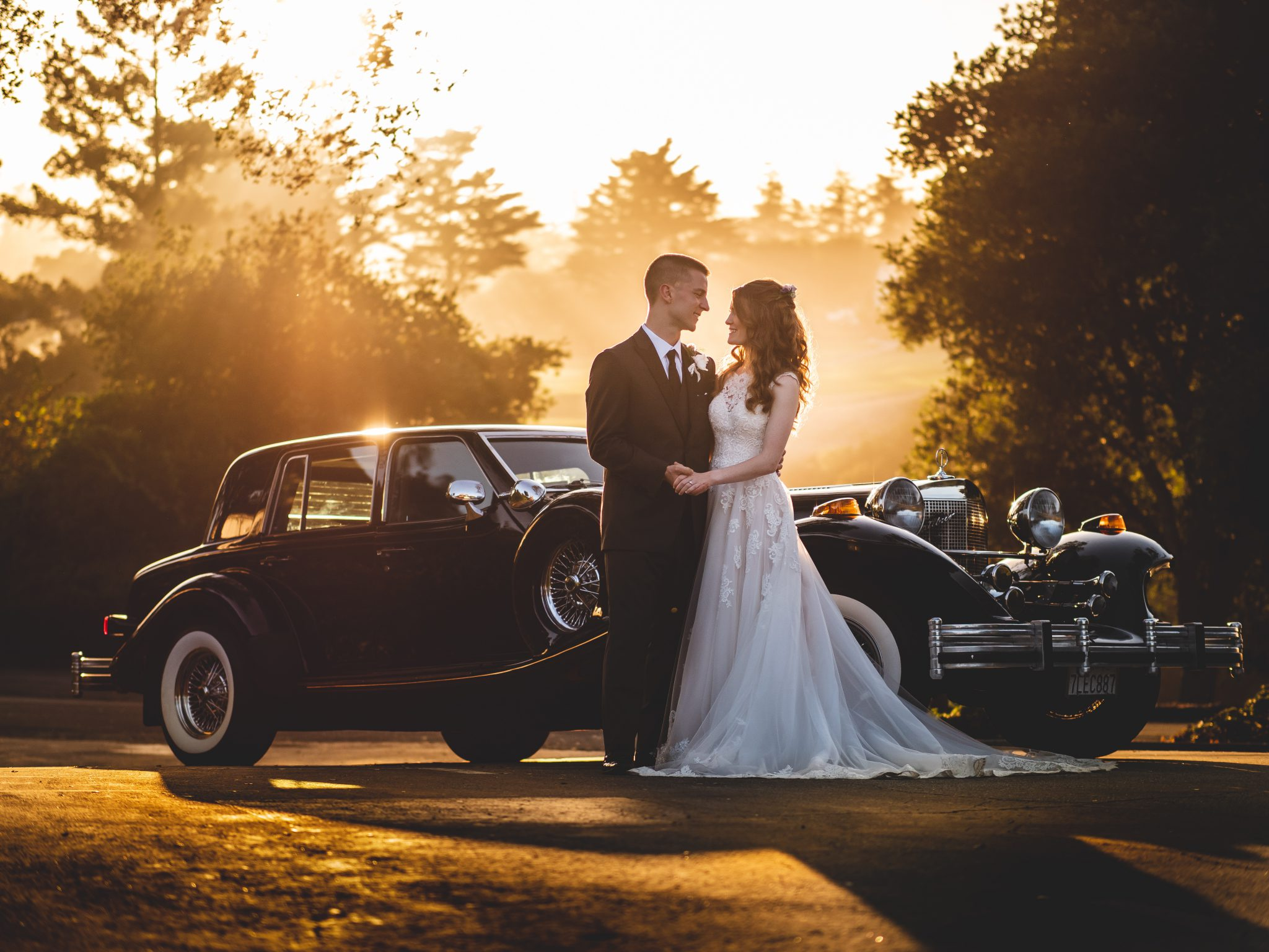 Hollins House couple with vintage car by Michael Anthony